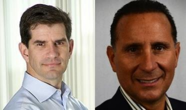 LogMeIn CEO Michael Simon left and Continuum CEO Michael George right are deepening their partnership