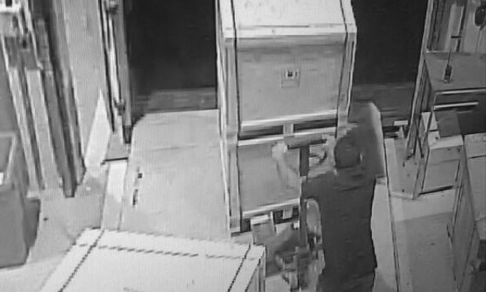 Security footage shows one of the robbers making off with a pallet of Samsung electronics