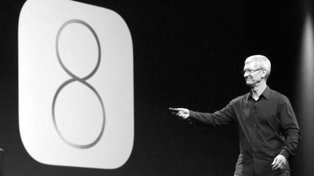 Apple CEO Tim Cook unveils iOS 8 during a launch event Sept 9