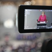 German Chancellor Angela Merkel is seen in a television camera monitor talking to the press Photo by Sean GallupGetty Images