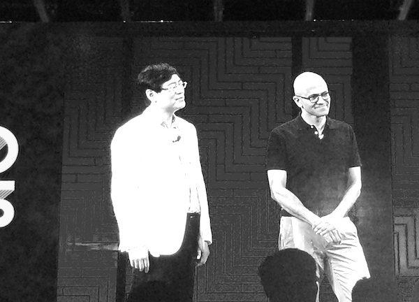 Lenovo CEO Yang Yuanqing left and Microsoft CEO Satya Nadella