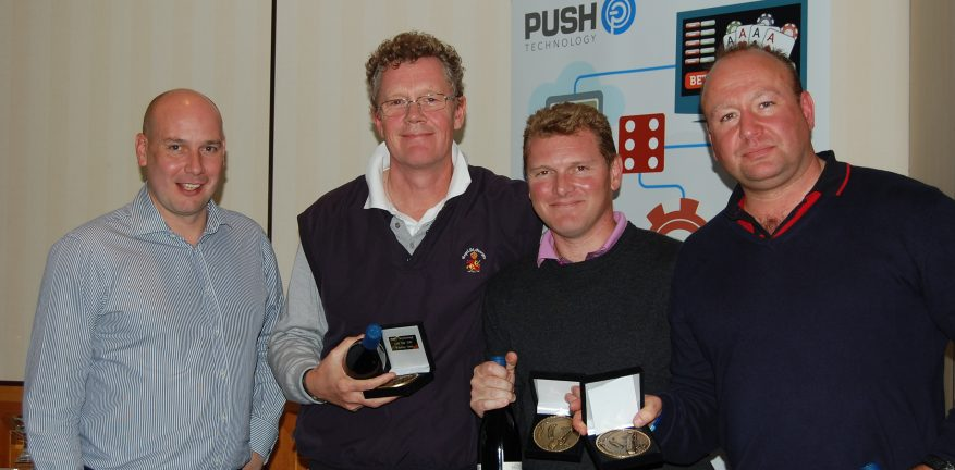 Push Technology CEO Sean Bowen far left poses with the winning team from a company golf tournament in 2012
