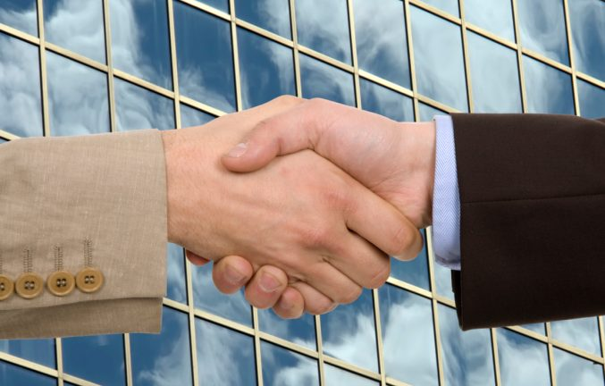 Handshake with clouds in the background