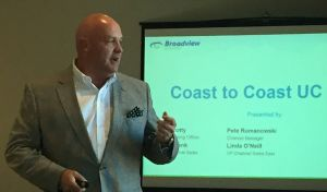 Broadview's Brian Crotty speaks at the company's Coast to Coast UC Tour, May 25, in Boston.