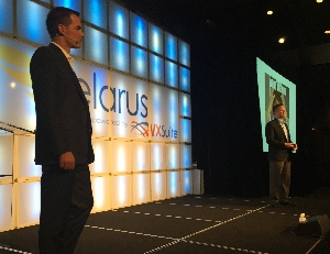 "CEO Adam Edwards (foreground) and co-founder Patrick Oborn deliver the ""State of Telarus"" address at the master agent's Partner Summit in Deer Valley, Utah, on June 22."