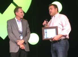 IronEdge's Ryan Lakin (right) accepts the award for New Customer of the Year at Tech Data Channel Link on June 16. On the left is TD's Marty Bauerlein.