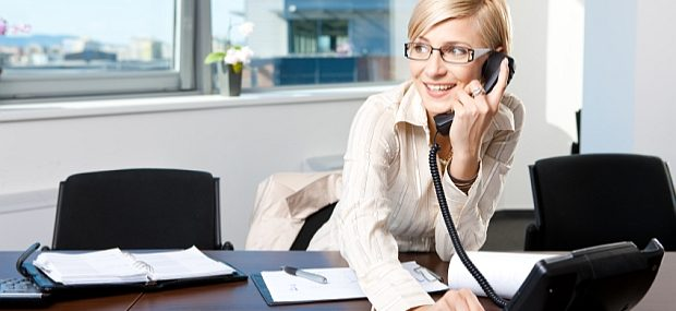 Businesswoman on desk phone
