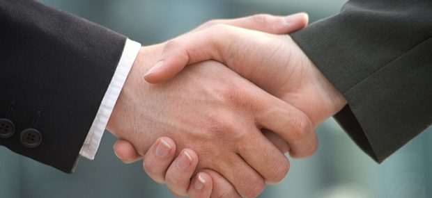 Business Handshake merger