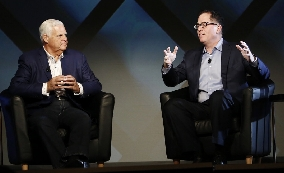 EMC's Joe Tucci (left) and Dell's Michael Dell on stage at EMC World in Las Vegas, March 2, 2016. Photo courtesy: EMC Corp.
