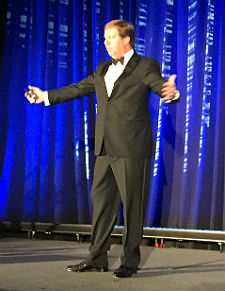 On stage Thursday at PlanetOne's Year-End Event in Scottsdale, Arizona, PlanetOne CEO Ted Schuman talks about some BIG deals.