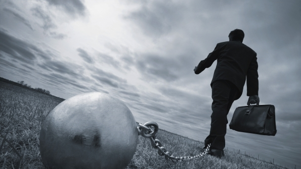 Man walking with ball and chain