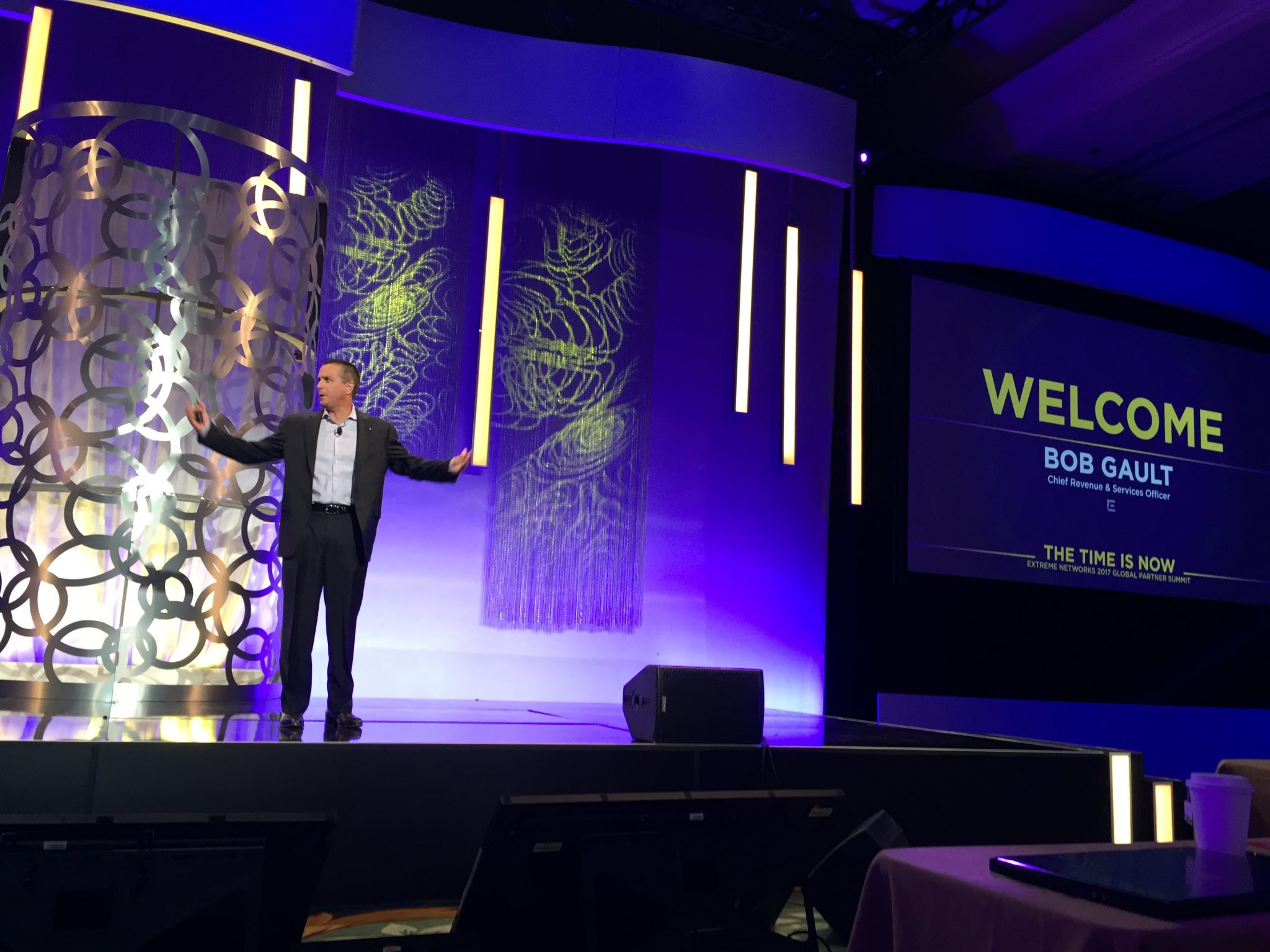 Extreme Networks' Bob Gault on stage at the company's global partner summit