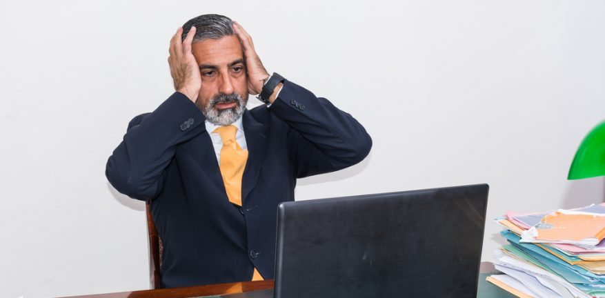 Scared Businessman at Computer