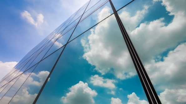 Clouds reflected by glass building