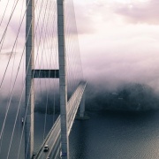 Suspension bridge shrouded in clouds
