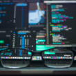Reading glasses in front of monitors