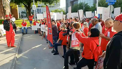 CWA Union members rally outside AT&T shareholder meeting in Dallas, April 27.