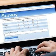Man completes survey online.