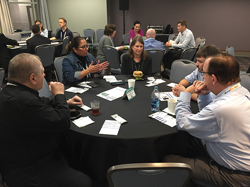 Howard Cohen (left) leads a roundtable discussion at the Business Hackathon.