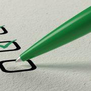 Checklist with green pen