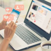 Social media on smartphone, laptop