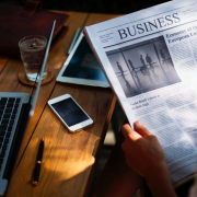 workspace with business newspaper being read