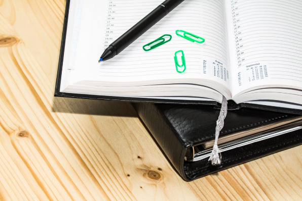 Planner book open on top of desk