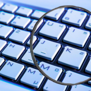 Magnifying glass over close up of keyboard