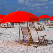 Summer beach scene with red umbrellas