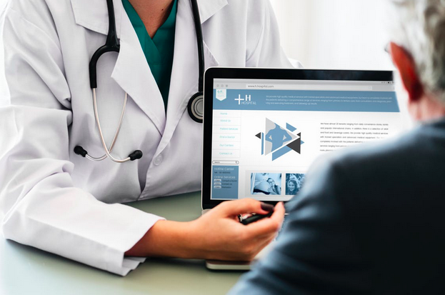 Doctor showing charts on screen to patient