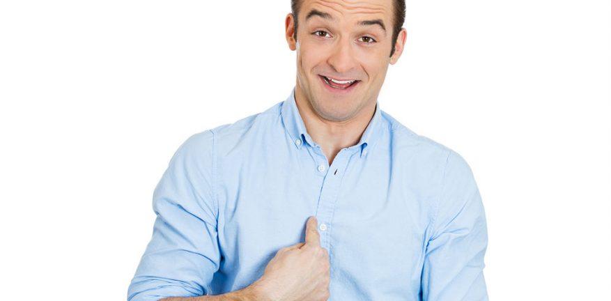 Man pointing at self