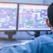 Security Operations Center Man with Monitors