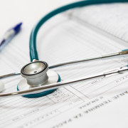 Stethoscope and medical forms