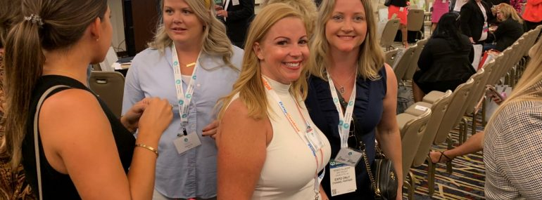 Women smiling at AWC at Channel Partners Evolution