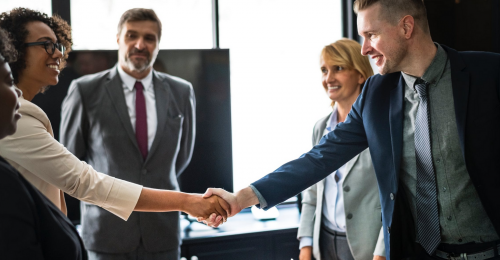 Businesspeople shaking hands meeting