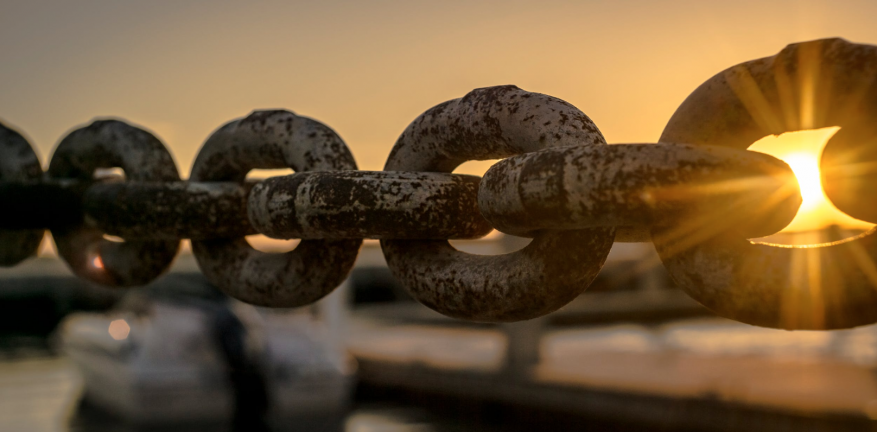 Chain with sun streaming through