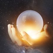 Person holding crystal ball