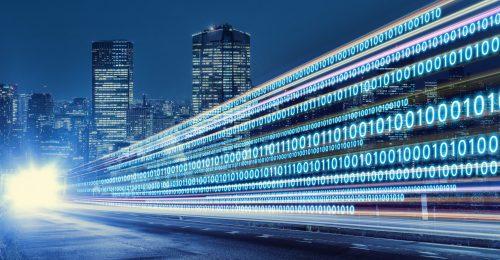 Digital signals flying over highway. Digital transformation. Internet of Things.