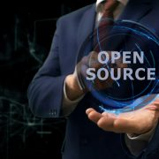 "Man holds orb with ""open source"" in it"
