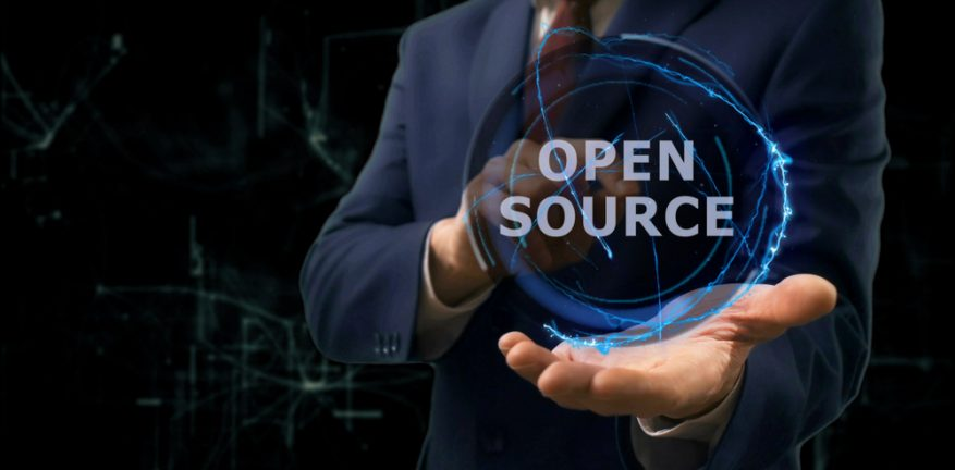 """Man holds orb with """"open source"""" in it"""
