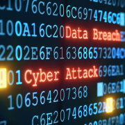 Digital code in blue with the words dta breach and cyber attack in red