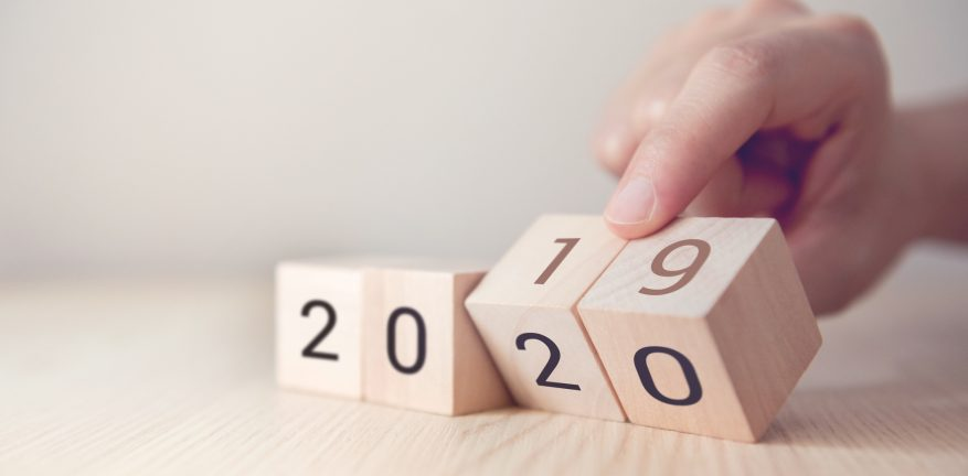 Hand change wooden cubes with New year 2019 to 2020 concept.