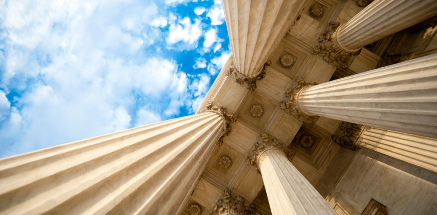Supreme Court Columns with Clouds