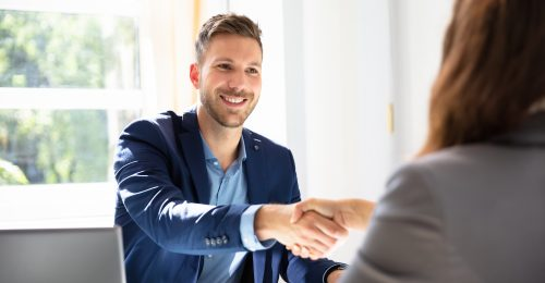Smiling Young Businessman Shaking Hands With His Partner