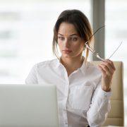 Businesswoman surprised at laptop