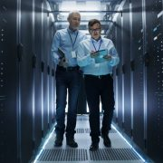 Two people in a data center