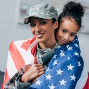 Woman of color soldier with daughter