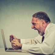 Angry Man at Computer