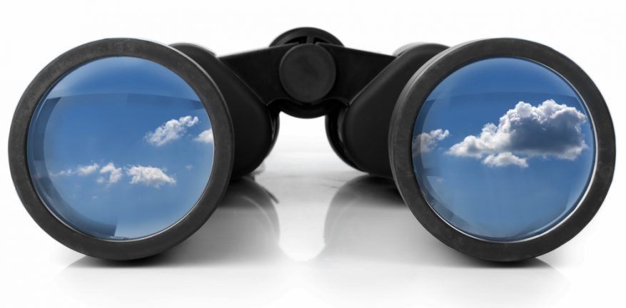 Binoculars with clouds in the lenses