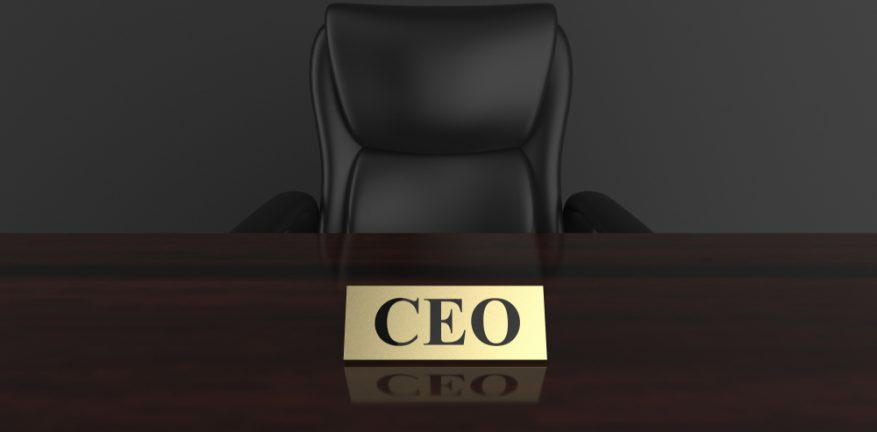 CEO's chair and desk, plus nameplate